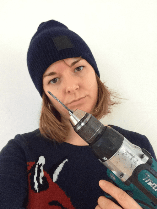 Getting to know my way around a drill…while wearing cashmere.
