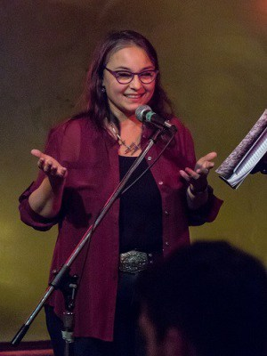 Margaret Christakos reading from Multitudes in 2014 at the Pivot Poetry Series, held at the Press Club on Dundas Street West. Photo: Ralph Kolewe.