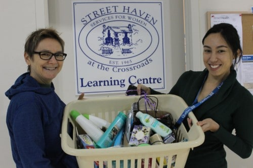 Photo: Mary Choy (right) accepts a donation of toiletries to the Street Haven Learning Centre. (via Facebook)